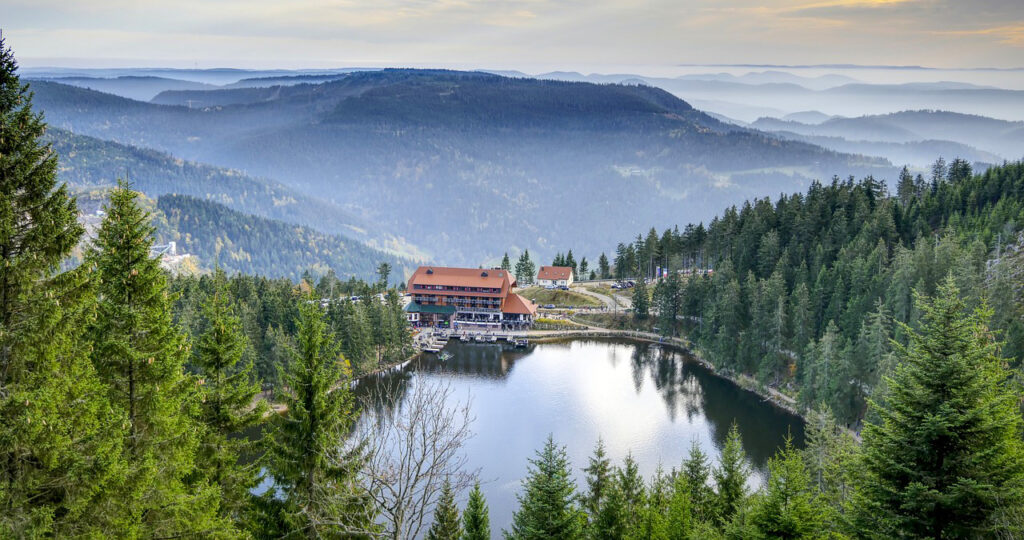 View of Mummelsee and mountain peaks in Black Forest Germany